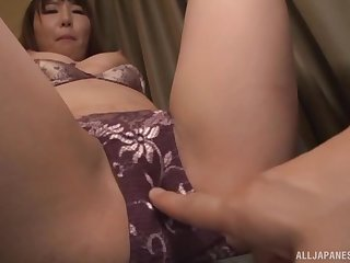 Japanese babe gets her panties abate and pussy fingered