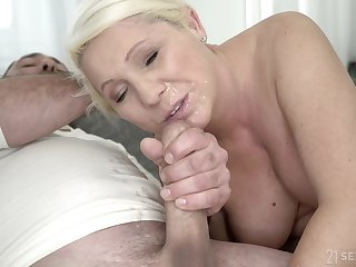 Of age blonde MILF Bibi Pink gets covered in cum after a hardcore make the beast with two backs