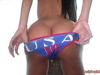 Gorgeous ladyboy Mos in USA team soccer outfit strips and exposes her beautiful goods.