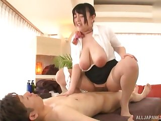 Mature Japanese BBW Mochida Yukari puts a cock between her huge tits