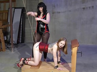 Jet-black haired lesbian mistress gives her blonde slave a rough intercourse session