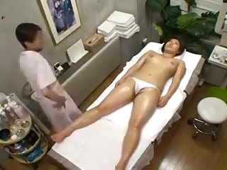 Big breasted Oriental hottie near a magnificent ass enjoys
