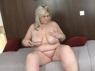 Amateur mature blonde MILF Margareta exposes her unselfish tits