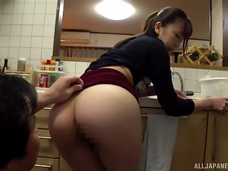 Ooura Manami is in the first place her knees in the kichen giving awesome blowjob