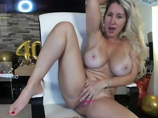 Breasty mommy plays with her ancient cunt on webcam