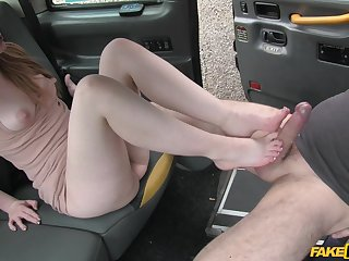 Hot ginger stimulates a cabbie just about her mouth, pussy with the addition of toes