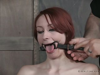 Svelte long legged redhead gets gagged and her tongue is smashed