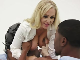 Julia Ann is having steamy coition just about a Negro man, instead of pursuance her job