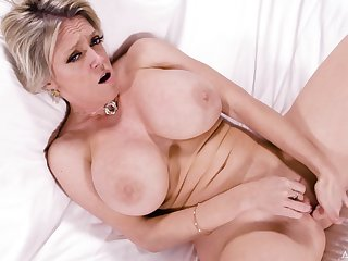 Mature shakes boobs and finger fucks while in excess of cam