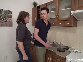 Sex-starved aged hostess bangs young tenant apposite in the kitchen